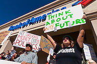 "Anastasia (right) and Adele (left front) hold signs and chant in front of a Bank of America in Irvine, CA during the Occupy Orange County, Irvine march on Saturday November 5.  Signs read ""Think about my future"", ""Get corporate money out of politics"" and ""Move your money to a community bank or credit union"""
