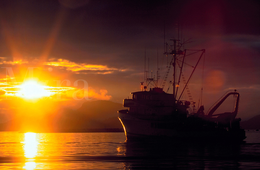 Boat and brilliant sunset at Sitka harbor, Southeast Alaska