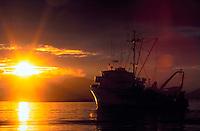 Boat and brilliant sunset at Sitka harbor, Southeast Alaska