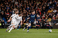 23rd November 2019; Estadio Santiago Bernabeu, Madrid, Spain; La Liga Football, Real Madrid versus Real Sociedad; Aritz Elustondo (Real Sociedad) breaks away from Carvajal and Benzema of Madrid