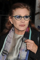 """27 December 2016 - Carrie Fisher, the iconic actress who portrayed Princess Leia in the Star Wars series, died Tuesday following a massive heart attack. Carrie Frances Fisher an American actress, screenwriter, author, producer, and speaker, was the daughter of singer Eddie Fisher and actress Debbie Reynolds. File Photo: 3 November 2014 - Westwood, California - Carrie Fisher. """"Dumb And Dumber To"""" Los Angeles Premiere held at the Regency Village Theatre. Photo Credit: Byron Purvis/AdMedia"""