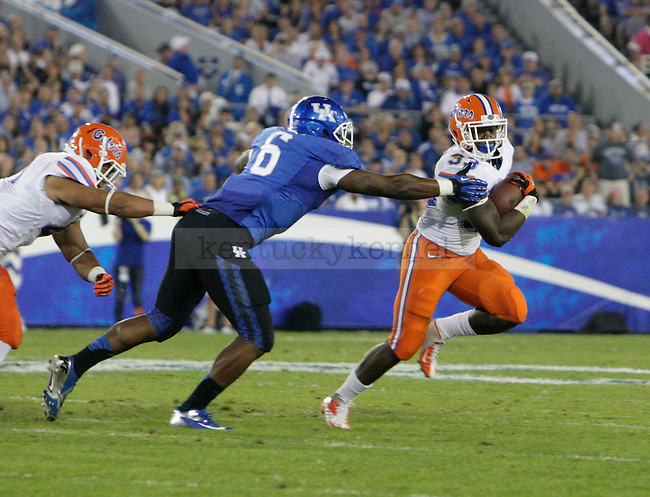Florida Gators running back Mack Brown (33) tries to break a tackle during the second half of the UK Football game against Florida at Commonwealth Stadium in Lexington, Ky., on Saturday, September, 28, 2013. Photo by Jonathan Krueger | Staff
