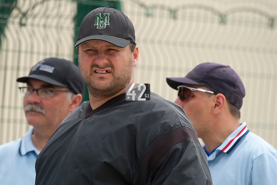22 May 2009: Team Manager Gregory Fages talks to the umpires during the 2009 challenge de France, a tournament with the best French baseball teams - all eight elite league clubs - to determine a spot in the European Cup next year, at Montpellier, France.