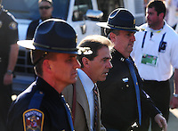 Jan 7, 2010; Pasadena, CA, USA; Alabama Crimson Tide head coach Nick Saban is escorted into the stadium with police prior to the game against the Texas Longhorns during the 2010 BCS national championship game at the Rose Bowl. Alabama defeated Texas 37-21. Mandatory Credit: Mark J. Rebilas-