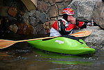 June 6, 2009:  Dustin Urban trys to stay warm between runs in the Men's Freestyle Kayak Finals competition at the Teva Mountain Games, Vail, Colorado.