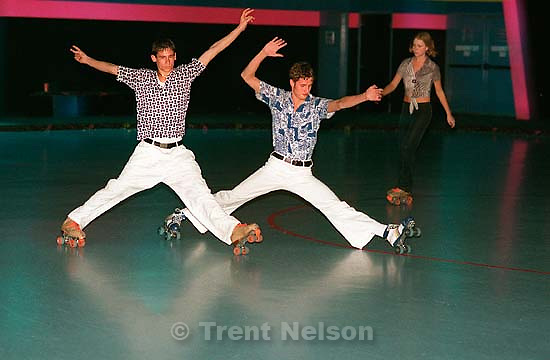 Kasey Kraatz (left) and Brett Chappuis skating on Disco night at Classic Skating in Sandy.<br />