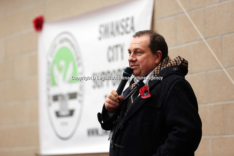 Swansea, UK. Sunday 09 November 2014<br /> Pictured: Kevin John, Swansea City chaplain and announcer. <br /> Re: Swansea City FC have unveiled a plaque for three former players who died during the First World War commemorating this way Remembrance Sunday. It was unveiled before the Barclays Premier League, Swansea City FC v Arsenal City at the Liberty Stadium, south Wales, UK