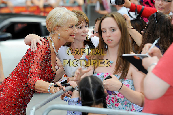 Dame Helen Mirren <br /> 'Red 2' European film premiere, Empire cinema, Leicester Square, London, England.<br /> 22nd July 2013<br /> half length red dress sheer beads beaded fans posing taking picture photograph side profile <br /> CAP/MAR<br /> &copy; Martin Harris/Capital Pictures