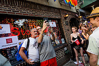 New York, NY 26 June 2015 - Lesbian and Gay families, advocates, and supporters gathered outside the Stonewall In, in Greenwich Village, to celebrate the Supreme Court decision that same-sex marriage is constitutional. Gay couples lined up to take selfies outside the landmarked Stonewall Inn