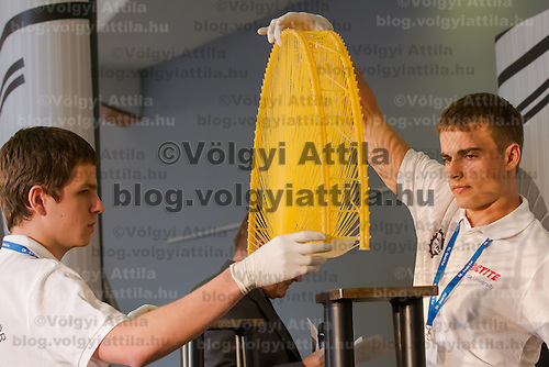 Competitors Miklos Vincze and Csaba Jaro prepare their construction for the winning test during the Spaghetti Bridge World Championship in Budapest, Hungary on May 24, 2013. ATTILA VOLGYI