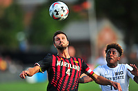 Alex Crognale of the Terrapins eyes the ball while keeping the defender at bay. Maryland defeated Penn State in over time 3-2 during an NCAA D-1 soccer match at Ludwig Field in College Park, MD on Sunday, September 18, 2016.  Alan P. Santos/DC Sports Box