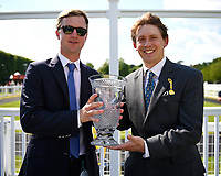 Connections of Eqtiraan receive their trophy for winning The British Stallion Studs EBF Cathedral Stakes (Listed)(Class 1),during Father's Day Racing at Salisbury Racecourse on 18th June 2017