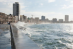 Havana, Cuba; waves crashing over the sea wall along the Malecon, the historic 4 mile seafront promenade along Havana's colonial center
