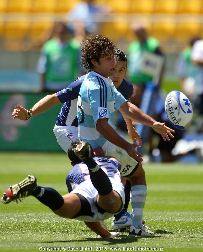 Nicolas Bruzzone passes in the tackle. Argentina v USA. NZI Wellington Sevens, Day One. Round one. Westpac Stadium, Wellington. 1 February 2008. Photo: Dave Lintott / lintottphoto.co.nz
