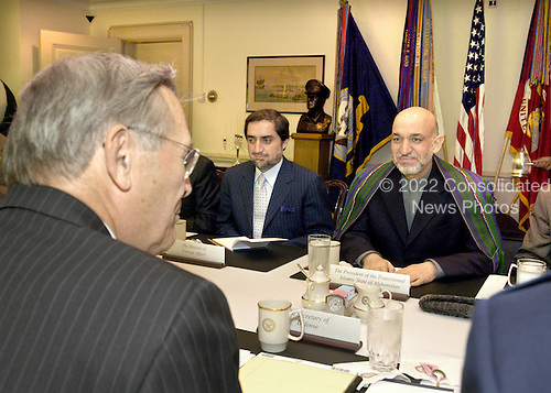 Washington, DC - June 14, 2004 -- President Hamid Karzai of Afghanistan (right) and Minister of Foreign Affairs Abdullah Abdullah (center) meet with United States Secretary of Defense Donald H. Rumsfeld (left foreground) in the Pentagon in Washington, D.C. on June 14, 2004, to discuss various security issues pertaining Afghanistan and its neighbors. .Credit: Robert D. Ward / DoD via CNP