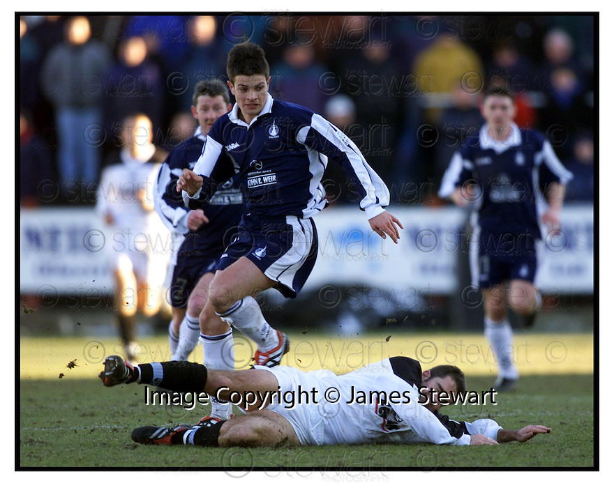 24th February 2001    Copyright Pic : James Stewart .Ref :                           .File Name : stewart05-falkirk v ayr utd.STEVEN CRAIG CONTINUES ON AS CRAIG MCEWAN HITS THE DECK.....Payments to :-.James Stewart Photo Agency, Stewart House, Stewart Road, Falkirk. FK2 7AS      Vat Reg No. 607 6932 25.Office : +44 (0) 1324 630007        Mobile : 07721 416997.Fax     : +44 (0) 1324 630007.E-mail : jim@jspa.co.uk.If you require further information then contact Jim Stewart on any of the numbers above.........