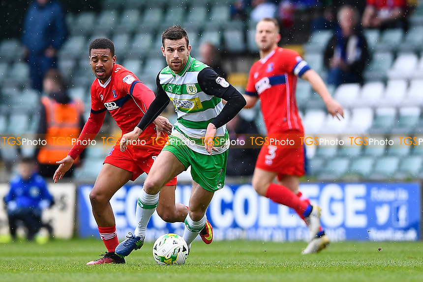Kevin Dawson of Yeovil Town brings the ball away from Reggie Lambe of Carlisle United left during Yeovil Town vs Carlisle United, Sky Bet EFL League 2 Football at Huish Park on 1st April 2017