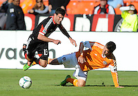 Chris Pontius (13) of D.C. United gets tackle by Bobby Boswell (32) of the Houston Dynamo. The Houston Dynamo defeated D.C. United 2-1, at RFK Stadium, Saturday October 27, 2013.