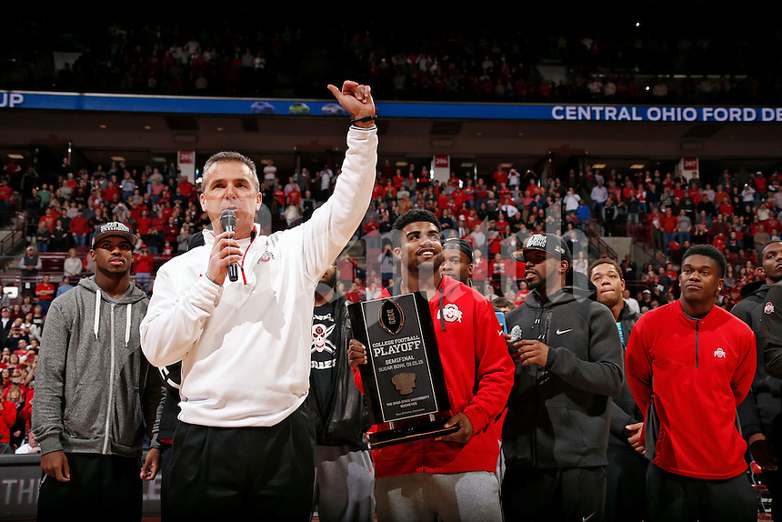 Ohio State Buckeyes head coach Urban Meyer speaks the crowd during a timeout of the basketball game against Illinois Fighting Illini during the 1st half of their NCAA basketball game at Value City Arena in Columbus, Ohio on January 3, 2014.  (Dispatch photo by Kyle Robertson)