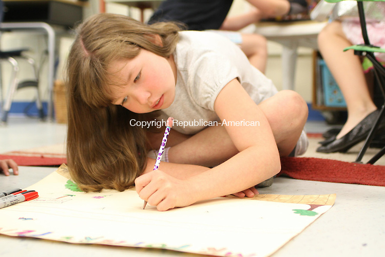 "WATERTOWN, CT-06 June 2013-060613LW07 -  Ella Makowski, 8, works on a poster about ""Mr. Popper's Penguins,"" a book she read for her book club at Judson Elementary School in Watertown June 6. Laraine Weschler Republican-American"