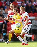 Doncaster Rovers' Brad Halliday gets away from Fleetwood Town's Jack Sowerby<br /> <br /> Photographer David Shipman/CameraSport<br /> <br /> The EFL Sky Bet League One - Doncaster Rovers v Fleetwood Town - Saturday 17th August 2019  - Keepmoat Stadium - Doncaster<br /> <br /> World Copyright © 2019 CameraSport. All rights reserved. 43 Linden Ave. Countesthorpe. Leicester. England. LE8 5PG - Tel: +44 (0) 116 277 4147 - admin@camerasport.com - www.camerasport.com