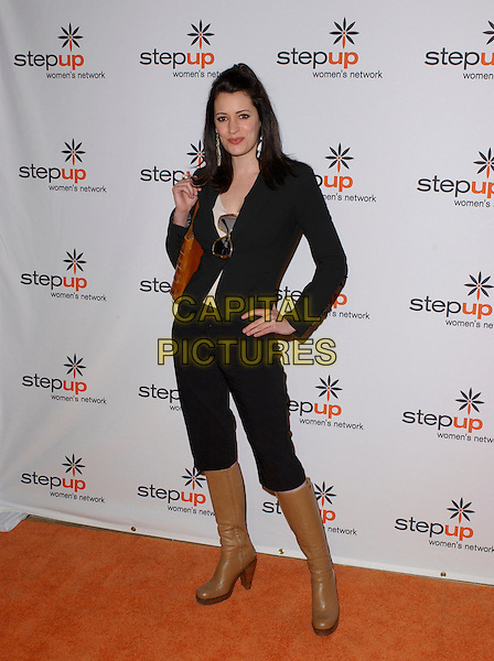 PAGET BREWSTER.Attends The Step Up Women's Network Inspiration Awards Luncheon held at The Beverly Hilton in Beverly Hills, California, USA, April 22nd 2005..full length beige knee high boots black jacket cropped trousers knee length hand on hip.Ref: DVS.www.capitalpictures.com.sales@capitalpictures.com.©Debbie VanStory/Capital Pictures