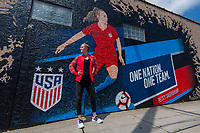 St. Louis, MO - May 15, 2019: USWNT defender Becky Sauerbrunn poses by a mural depicting her in St. Louis.