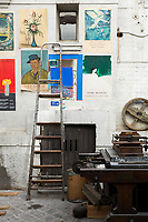 A 19th-century Paris printworks is defying its age and serving as a creative hub for contemporary artists. The studio's walls are covered with old posters