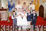 The pupils of Augacasla NS who made their First Holy Communion on Saturday were front l-r: Owen Garvey, Shauna Buckley, Eimear O'Donoghue, Lenny McGaley and Shane Deane. Back l-r: Adam O'Donnell Ferriter, Luke McNamara, James Bowler and Stephen Smith Galvin with Fr Hussey, teacher Caroline McCrohan and Fr John Buckley at back,
