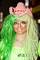 A female customer who has been transformed into a ganguro girl poses for pictures in the Shibuya shopping area on September 4, 2015. <br /> <br /> Ganguro is an alternative Japanese fashion trend which started in the mid-1990s where young women, rebelling against the traditional idea of Japanese beauty, wore colorful make-up and clothes and had dark-skin.<br /> <br /> 10 Ganguro fashion girls work in the new bar, which offers original Ganguro Balls (fried takoyaki style sausage balls in black squid ink batter) on its menu. Ganguro Caf&eacute; &amp; Bar also offers special services such as Ganguro make-up and the chance to take purikura (photo booth pictures) with staff and to look like a Ganguro girl walking around the Shibuya streets.<br /> <br /> The bar is popular with both Japanese and foreigners and has menus translated in English. (Photo by Rodrigo Reyes Marin/AFLO)