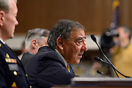 February 14, 2012  (Washington, DC)  Secretary of Defense, Leon Panetta (center) testifies before the Senate Armed Services Committee regarding the FY2013 defense budget.  Chairman of the Joint Chiefs of Staff, General Martin Dempsey (left), and Under Secretary of Defense (Comptroller) Robert Hale (right) listen as Panetta speaks.   (Photo by Don Baxter/Media Images International)
