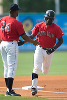 Kannapolis second baseman Brandon Johnson is congratulated by third base coach Joe Hall following his solo home run in the bottom of the first inning versus the Augusta Green Jackets at Fieldcrest Cannon Stadium in Kannapolis, NC, Sunday, June 18, 2006.