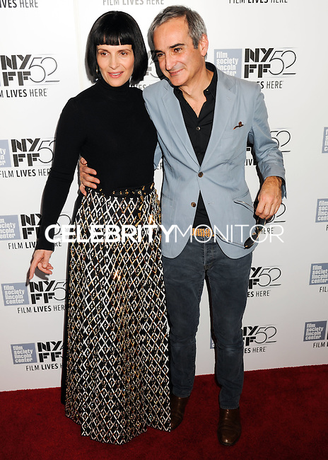 NEW YORK CITY, NY, USA - OCTOBER 08: Juliette Binoche, Olivier Assayas arrive at the 52nd New York Film Festival - 'Clouds Of Sils Maria', 'Merchants Of Doubt' And 'Silvered Water' Premieres held at Alice Tully Hall on October 8, 2014 in New York City, New York, United States. (Photo by Celebrity Monitor)