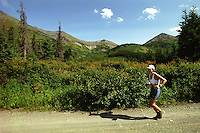 Laura McDonough competes in the 2004 Resurrection Pass Trail 100-Miler ultramarathon race through the Kenai Mountains in the Chugach National Forest between Cooper Landing and Hope, Alaska.