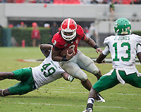 The Georgia Bulldogs played North Texas Mean Green at Sanford Stadium.  After North Texas tied the game at 21 early in the second half, the Georgia Bulldogs went on to score 24 unanswered points to win 45-21.  Georgia Bulldogs running back Todd Gurley (3), North Texas Mean Green defensive end Daryl Mason (49)