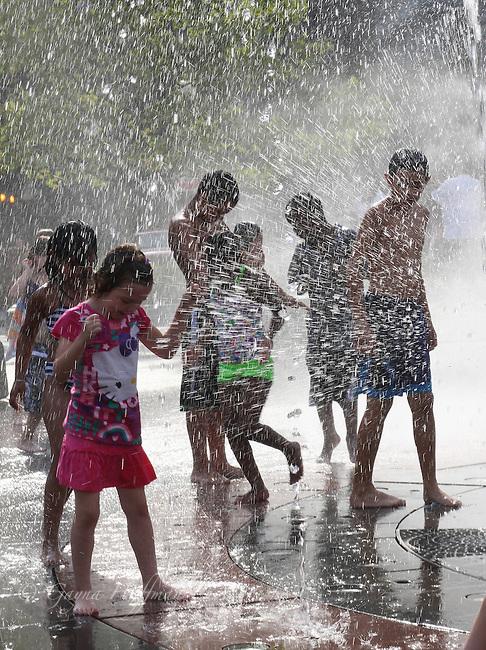 Children playing in water splash park, Wharf District, Boston, MA