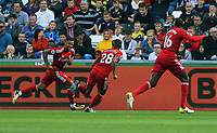 Andre Gray of Watford (L) celebrates his opening goal during the Premier League match between Swansea City and Watford at The Liberty Stadium, Swansea, Wales, UK. Saturday 23 September 2017