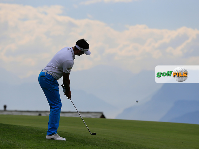 Lee SLATTERY (ENG) chips onto the 7th green during Thursday's Round 1 of the 2014 Omega European Masters held at the Crans Montana Golf Club, Crans-sur-Sierre, Switzerland.: Picture Eoin Clarke, www.golffile.ie: 4th September 2014