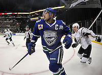 Utica Comets left wing Colin Stuart races San Antonio Rampage defenseman Michael Caruso to the puck during the first period of an AHL hockey game, Monday, Jan. 13, 2014, in San Antonio (Darren Abate/AHL)