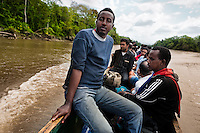 A Somali immigrant, followed by Nepalese immigrants, travel on a canoe while crossing the jungle of Darién gap in Panama, 30 January 2015.