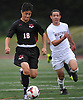 Ethan Koval #18 of Half Hollow Hills East, left, looks to stay ahead of Thomas Jose Garcia #5 of Whitman during the first half of a Suffolk County League II varsity boys soccer game at Whitman High School on Monday, Sept. 19, 2016. Koval scored a goal in the fourth minute of play. Hills East won by a score of 2-1.