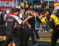 Feb 25, 2018; Chandler, AZ, USA; Bob Lagana , crew member for NHRA top fuel driver Steve Torrence (not pictured) celebrates with NHRA chief starter Mike Gittings during the Arizona Nationals at Wild Horse Pass Motorsports Park. Mandatory Credit: Mark J. Rebilas-USA TODAY Sports
