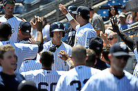 Staten Island Yankees first baseman Casey Stevenson #28 is greeted by teammates after hitting a homerun during a game against the State College Spikes at Richmond County Bank Ballpark at St. George on July 14, 2011 in Staten Island, NY.  Staten Island defeated State College 6-4.  Tomasso DeRosa/Four Seam Images