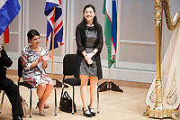 Jury Member Dan Yu of China stands for recognition during the opening ceremony of the 11th USA International Harp Competition at Indiana University in Bloomington, Indiana on Wednesday, July 3, 2019. (Photo by James Brosher)