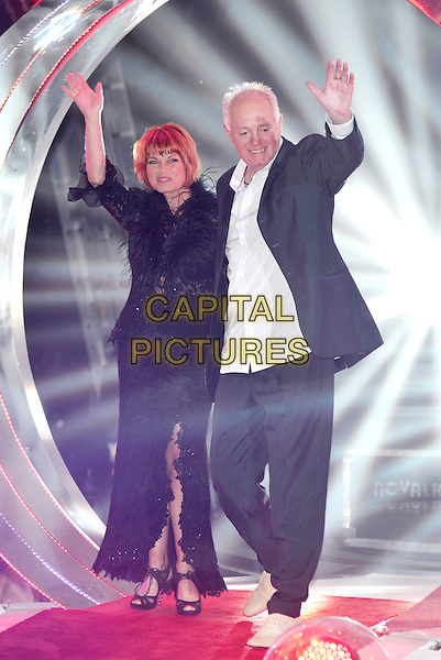 Vicky Entwhistle, Bruce Jones<br /> 'Celebrity Big Brother 2013' arrivals at Elstree Studios, Borehamwood, England 22nd August 2013<br /> CBB full length black lace dress suit jacket white shirt fur arms waving hands <br /> CAP/PL<br /> &not;&copy;Phil Loftus/Capital Pictures