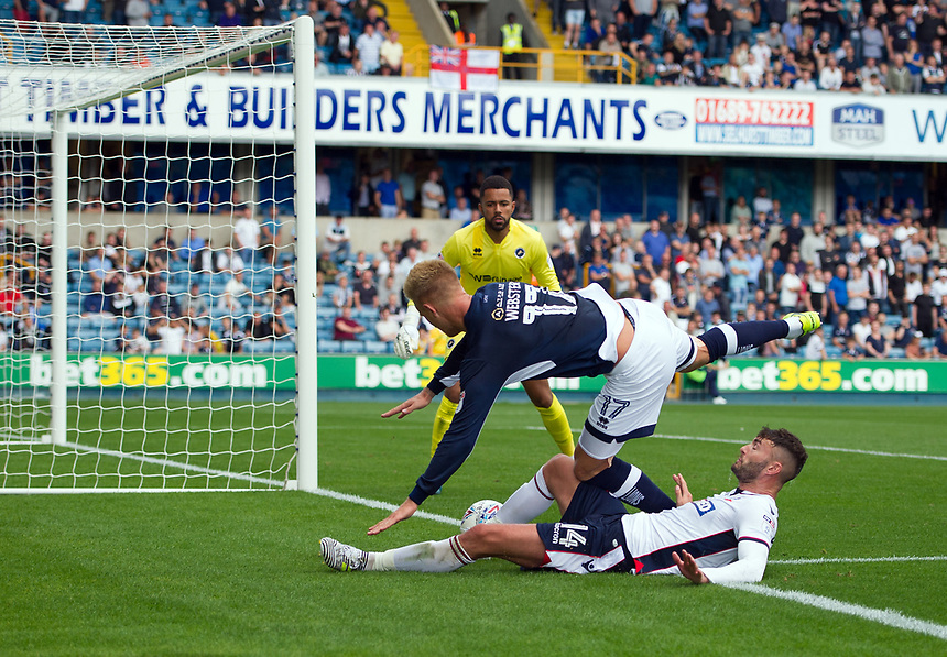 Bolton Wanderers' Gary Madine battles for possession with Millwall's Byron Webster<br /> <br /> Photographer Ashley Western/CameraSport<br /> <br /> The EFL Sky Bet Championship - Millwall v Bolton Wanderers - Saturday August 12th 2017 - The Den - London<br /> <br /> World Copyright &not;&copy; 2017 CameraSport. All rights reserved. 43 Linden Ave. Countesthorpe. Leicester. England. LE8 5PG - Tel: +44 (0) 116 277 4147 - admin@camerasport.com - www.camerasport.com