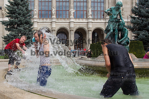 Young people participate in a public water fight in central Budapest, Hungary on August 25, 2013. ATTILA VOLGYI