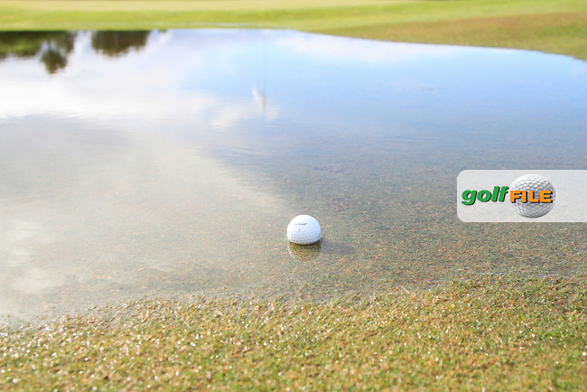 In a pool of water at the back of the 9th green during Round 1 of the NH Collection Open at the La Reserva de Sotogrande Club de Golf in Cadiz Spain on Thursday 3rd April 2014<br /> Picture:  Thos Caffrey / www.golffile.ie
