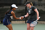SAN DIEGO, CA - APRIL 25:  Catherine Isip and Anna Chikhikvishvili of the Saint Mary's Gaels after clinching the doubles point during the WCC Tennis Championships at the Barnes Tennis Center on April 25, 2010 in San Diego, California.