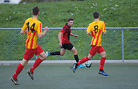 Action from the 2018 Men's Capital Division One football match between Brooklyn Northern United (red and black) and Stokes Valley (gold and red) at Wakefield Park in Wellington, New Zealand on Saturday, 26 May 2018. Photo: Dave Lintott / lintottphoto.co.nz